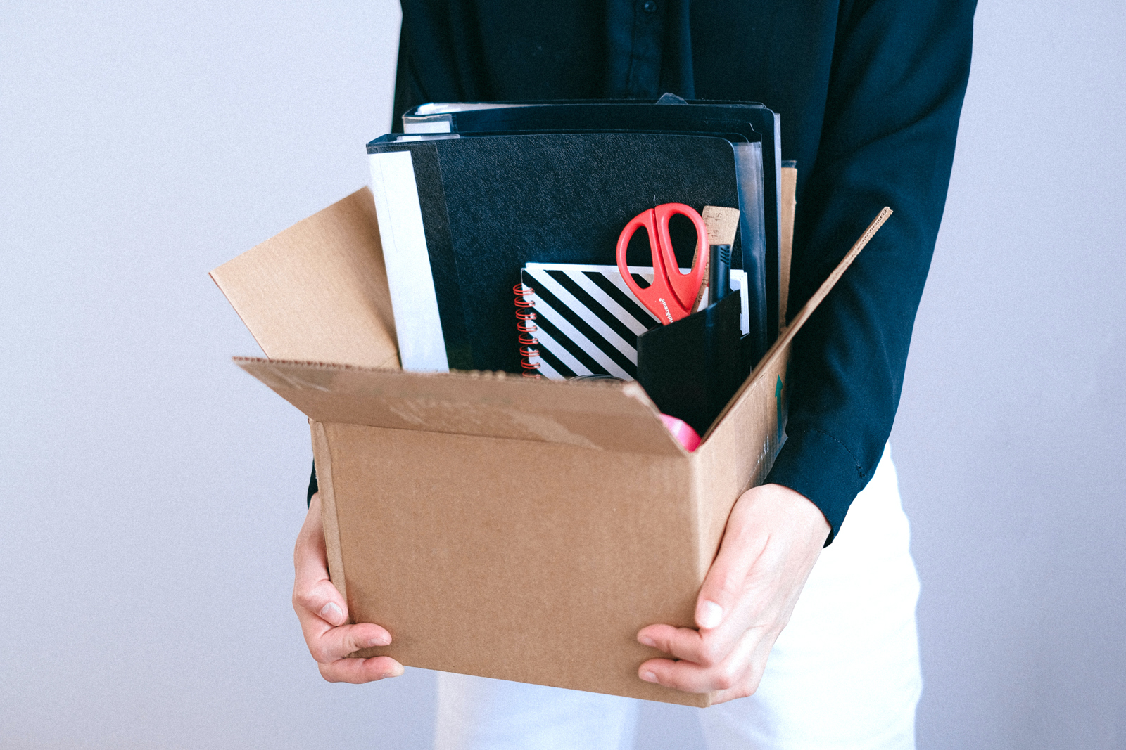 employee leaving job with box